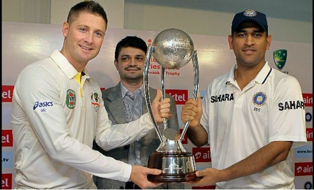Michael Clarke & MS Dhoni pose w/ the Border-Gavaskar Trophy (from examiner.com)
