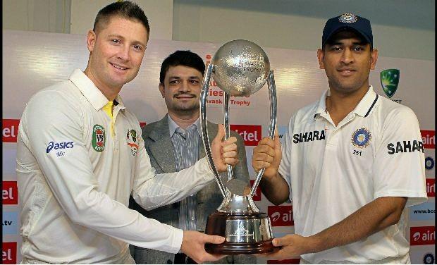 Michael Clarke & MS Dhoni pose w/ the Border-Gavaskar Trophy (from examiner.com)