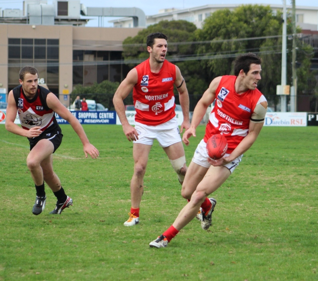 Northern Blues players shepherd & get chased at Preston City Oval (photo mine)