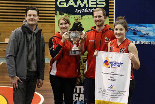 La Trobe team captains & manager accept the 2013 SUG winners trophy (photo: Australian University Sport)