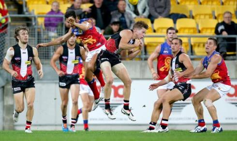 Billings & Raines collide in a tough contest on ANZAC Day (photo: AFL Media)