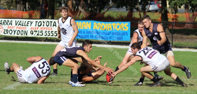 Players dive for the ball in East Burwood's forward 50 (photo: Davis Harrigan)
