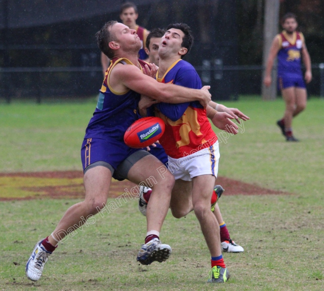 Clash of bodies between Doncaster East (L) and Mulgrave (R) at Zerbes Reserve (photo: Davis Harrigan)