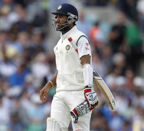 Cheteshwar Pujara heads to the pavilion as India crumble (photo: ESPN Cricinfo/Getty Images)
