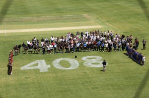 Observing a minutes silence at Adelaide No. 2 Oval (photo: Davis Harrigan)
