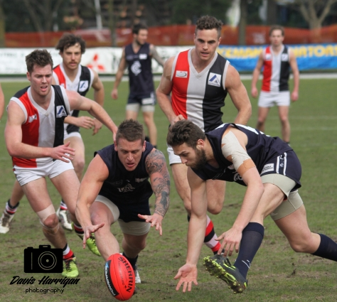 Croydon players go in for the ball against North Ringwood (photo: Davis Harrigan)