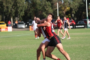 Jake Hammond fights in the ruck against his North Ringwood opponent (photo: Davis Harrigan)